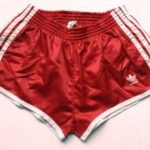 red vintage adidas shorts with full white trim